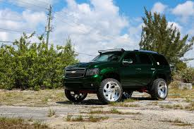 chevy lifted lifted chevy taho rides on forgiatos looks fresh in green