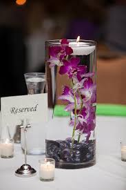 purple wedding centerpieces i did this at my wedding except w lillie s roses and greenery