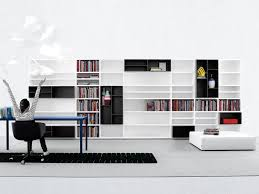 living room wood wall storage system design with black and white