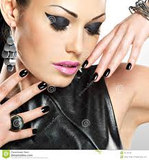 beautiful fashion woman with black nails at pretty face stock