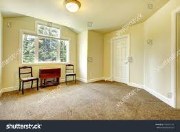 yellow walls living room new empty room yellow walls brown stock photo 108401123 shutterstock
