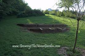 another raised bed this time on a slope growing the home garden