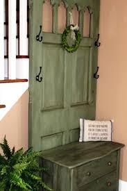 artistic old door entry bench using green distressed wood