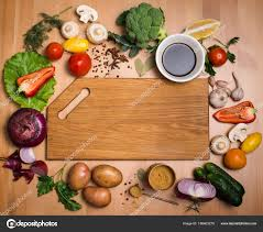 cutting board plates colorful ingredients for cooking on rustic wooden table around