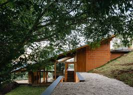 half slope house steps into a hillside in rural brazil house