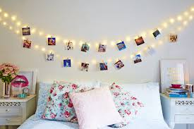 bedroom with wall fairy lights and hanging photos pretty bedroom