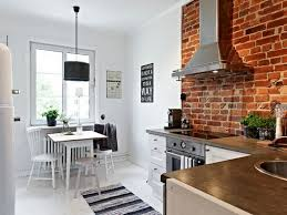 scandinavian apartment interior with exposed brick wall kitchen