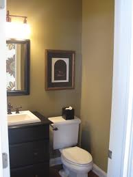 wall lamp and toilet and trash bin square wall mirror idea grey