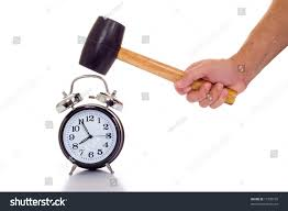 Old Fashioned Alarm Clocks A Hand Holding A Black Mallet Or Hammer About To Crush An Old