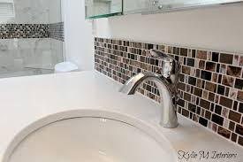 pink and brown marble mosaic tile with white quartz undermount