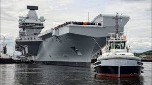 launch of britains largest royal navy ship named hms queen
