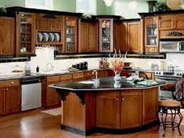 maple cabinets with black island black and white kitchen granite cou wooden tables chairs brown metal