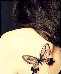 black butterfly tattoos on upper back for girls tats pinterest