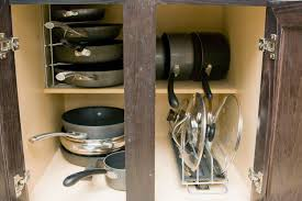 pots and pans and lids storage with stainless steel pull out rack