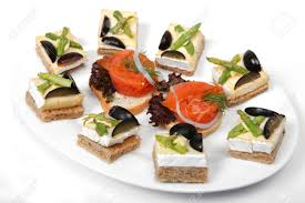 canape toast a plate of brie cheese on toast canapes and smoked salmon on stock