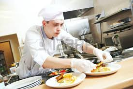 cooking chef cuisine cook chef in white decorating food on the