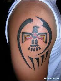 bird colored tribal tattoo on shoulder tattoo wf