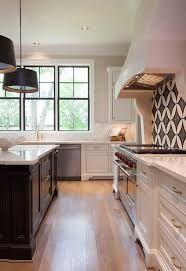 white kitchen black island white kitchen with black island and white marble countertops