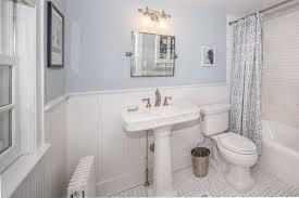 cape cod bathroom designs traditional bathroom with wainscoting tiled wall showerbath