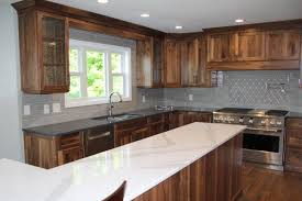 what color countertops with walnut cabinets omega walnut cabinets cambria britannica quartz