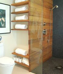 reclaimed wood shelves a trendy addition to a modern bathroom