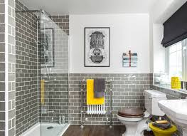 Grey And Yellow Bathroom Accessories by Bathroom With Grey Tiles And Yellow Accents Grey And Yellow