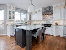 how to paint stained cabinets white painted vs stained cabinets jm kitchen and bath design