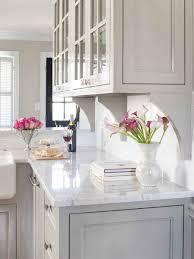 white kitchen wood island granite countertop white buffet cabinet backsplash tile samples