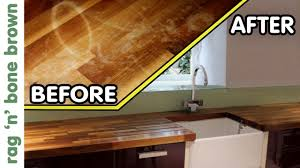 what should you use to clean wooden kitchen cabinets how to remove stains re finish wooden kitchen counter worktops
