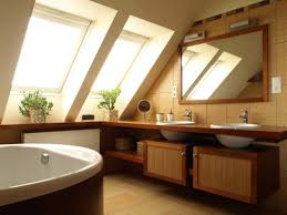 attic bathroom with rectangular window and skylights the types