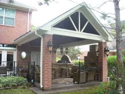 gable roof patio cover with outdoor kitchen u0026 fireplace texas