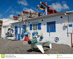 artistic and weird well decorated house on the beach stock photo