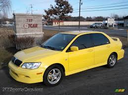 mitsubishi yellow 2003 mitsubishi lancer oz rally in lightning yellow 084251