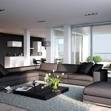 low height black coffee table and grey l shaped sofa for modern