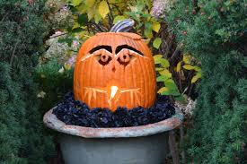 halloween pumpkin head jack lantern with burning candles over black background detroit garden works dirt simple part 5