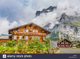 traditional farmhouses in idyllic mountain scenery with high
