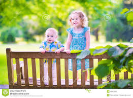 two little kids on a park bench stock photo image 43310525