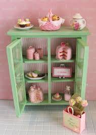 miniature shabby chic cabinet filled with pink sweets that i sell