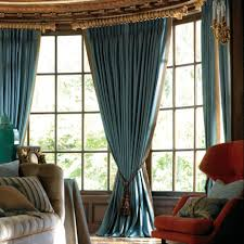 living room formal design with long blue windows curtains and red