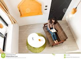 top view of woman reading book and sitting on sofa stock photo