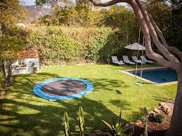 Trampoline Backyard 7 Things That Can Make Your Backyard Really Cool And Awesome