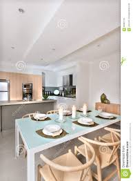 modern dining room setup with candles flashing in front of the