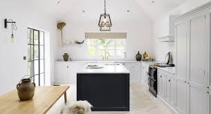 lofty modern farmhouse kitchen with shaker cabinets u0026 skylights