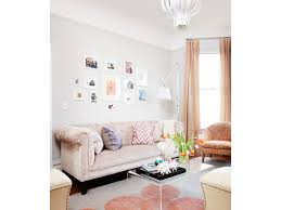 living room coddington design silk curtains white ottomans blush