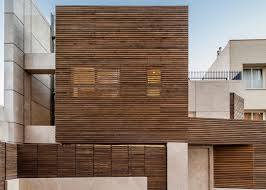 modern home in iran features striking slatted timber exterior curbed