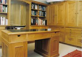 inspiring office room design which is implemented with two sides of bookshelves and facing simple solid oak desks for home office also red carpet jpg