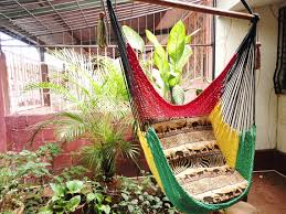 red yellow and green rasta sitting hammock hanging chair