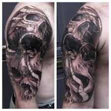 cross tattoo coverup with skulls half sleeve tattoo maximilian