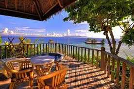 sky clouds sea mountain island verandah table chairs tree sports