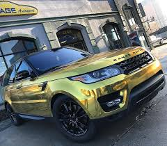 wrapped range rover evoque new age autosport range rover sport wrapped in gold chrome with